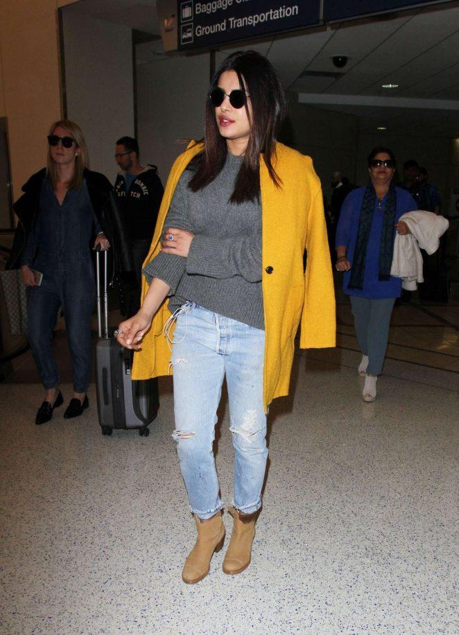 Actress Priyanka Chopra In Blue Top Jeans at Airport