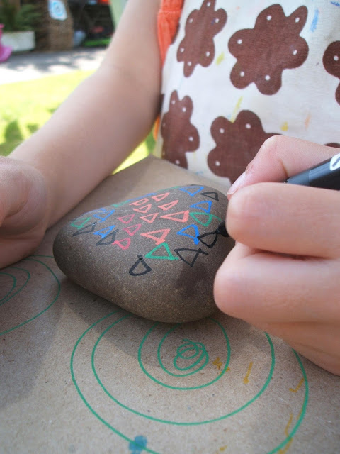 creating pebble art with posca pens