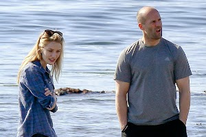 Rosie Huntington-Whiteley and Jason Statham walking with pets