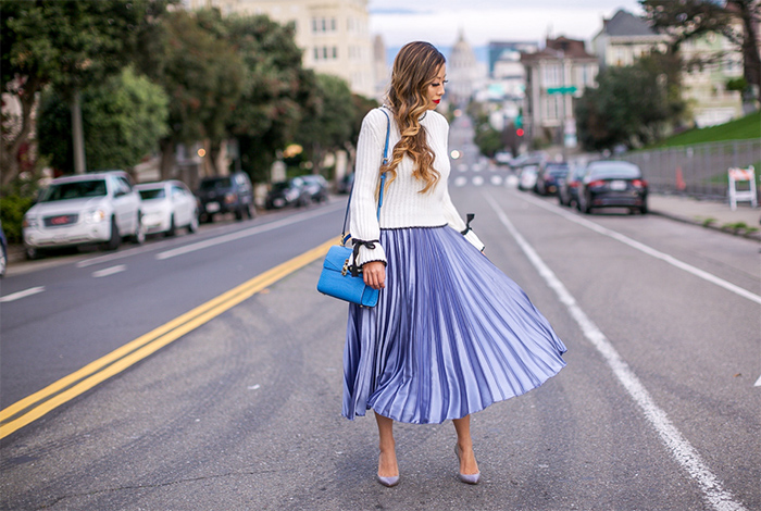 Bow bell sleeve sweater, silver blue pleated midi skirt, as seen on me, henri bendel uptown mini crossbody bag, baublebar earrings, christian louboutin glitter pumps, san francisco street style, san francisco fashion blog