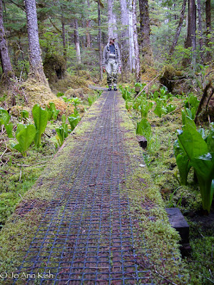 Angler on a boardwalk in Southeast Alaska