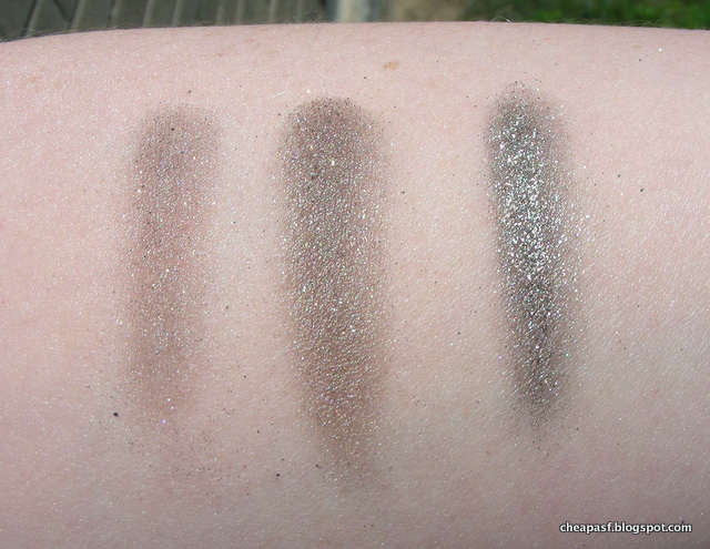Swatches of Laura Mercier Baked Eyeshadow in Black Karat and L'Oreal Infallible eyeshadow in Gilded Envy
