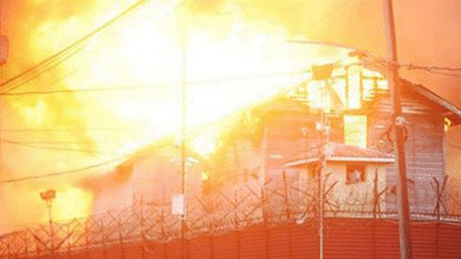 Rebellious inmates burn Guyana prison, fight police