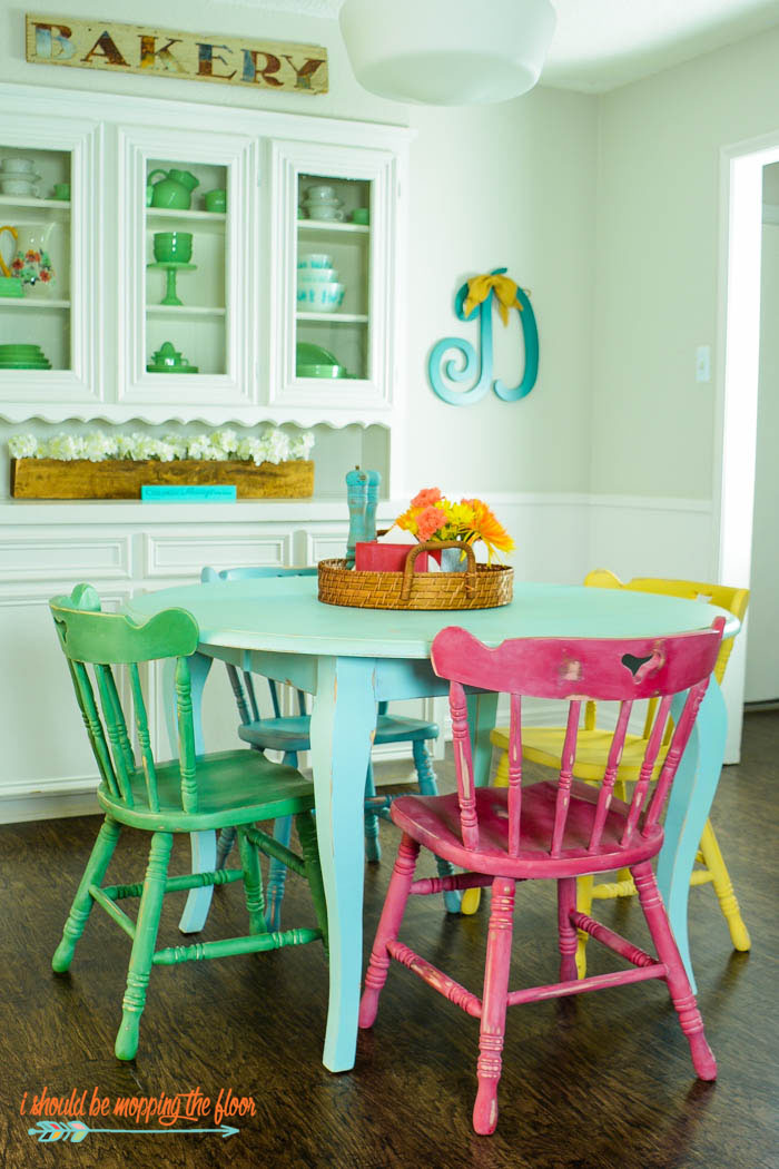 Table and Chairs Makeover with Chalk-Style Paint | Multi-colored chalk style paints and white wax make this vintage piece really pop! Check out the full makeover at ishouldbemoppingthefloor.com.