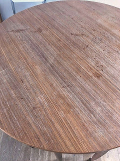 Scratched and stained table top