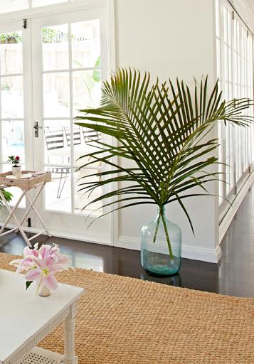 Large Palm Leaf Fronds in Demijohn Glass Floor Vase