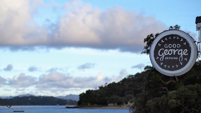 Good George Brewing sign at sunset over the Bay of Islands New Zealand