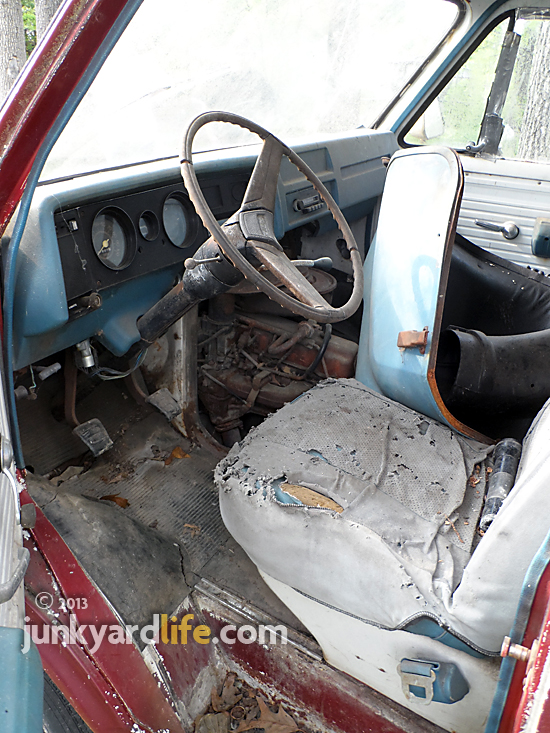 Original blue driver's seat and dash inside this 1974 GMC Vandura.