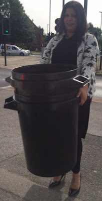 Cllr Zahira Naz carrying litter bins into Darnall Forum