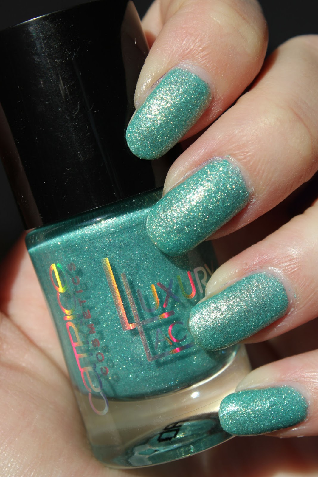 http://lacquediction.blogspot.de/2014/02/catrice-luxury-lacquers-sandsation-c03.html