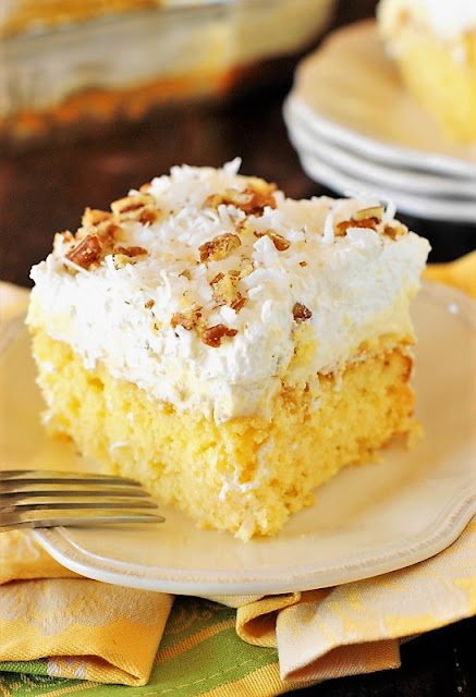 Hawaiian Dream Cake image ~ a layered delight with pineapple-and-coconut laced yellow cake base, layer of creamy pineapple pudding, and freshly whipped cream and coconut topping.  Cool, creamy, & comforting!
