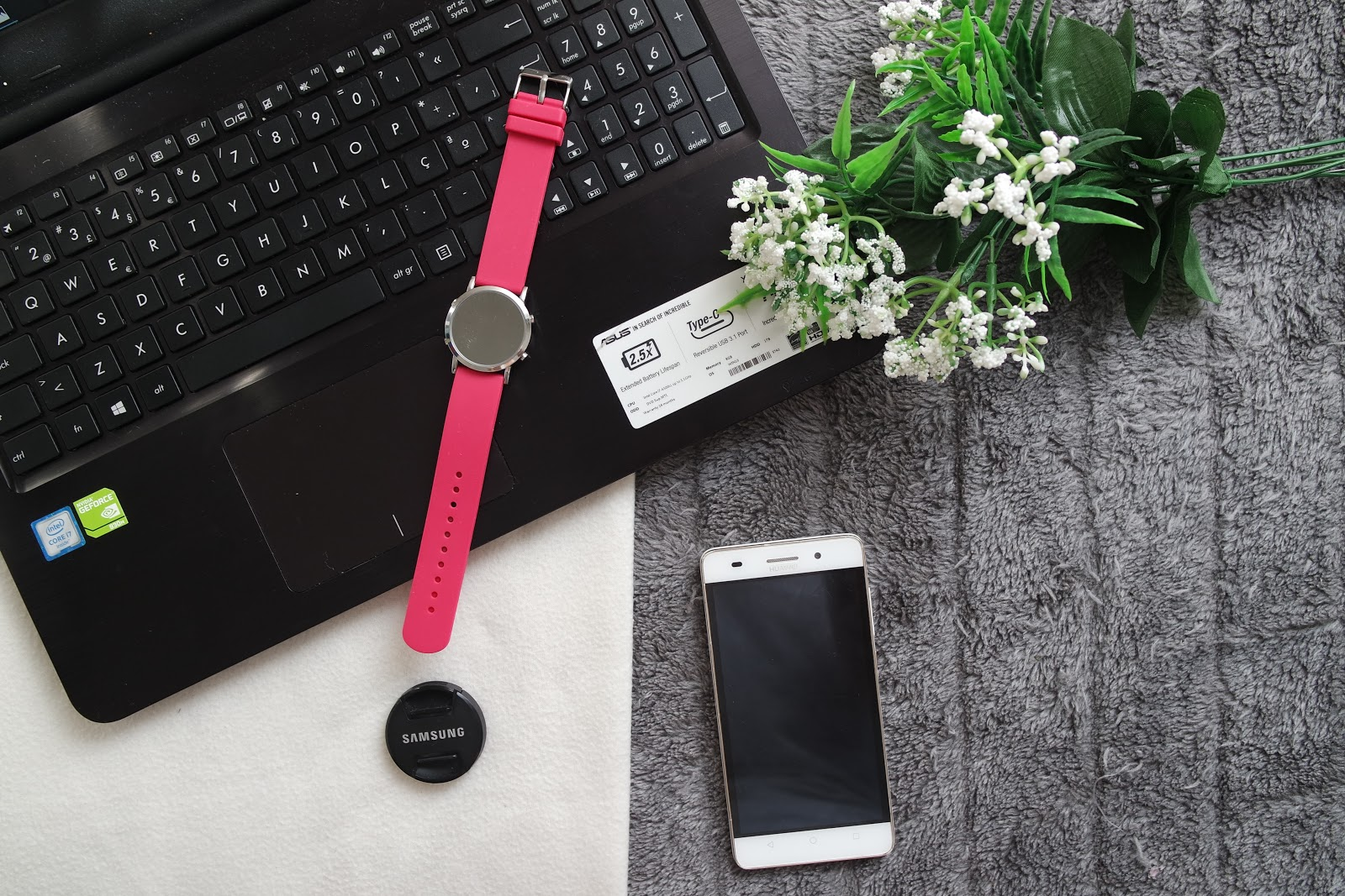 How to get more Blog Traffic: flatlay of a laptop, phone, pink watch and some flowers