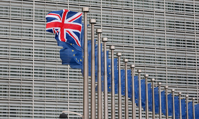A Union Jack flies next to European Union flags at the European Commission in Brussels for a visit by British Prime Minister David Cameron (January 29, 2016) Protograph by Laurent DuBrule