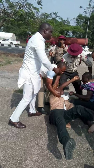 Photos Of Cross Rivers Commissioner, Driver Go Thugger;, Fights FRSC Official Dirty In Public