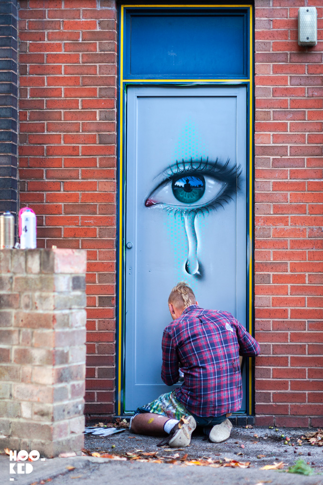 Street Artist My Dog SIghs at work in Cheltenham, UK for the Cheltenham Paint Festival