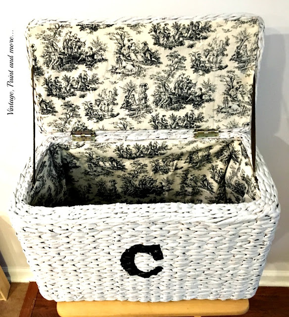 an old hamper recycled with paint, stenciling, and fabric