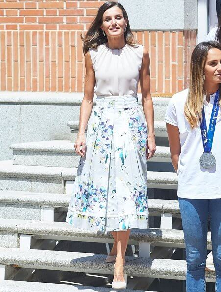 Queen Letizia wore Adolfo Dominguez floral print dress. She wore Hugo Boss silk blouse. 2020 Tokyo Olympics