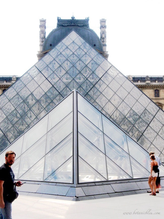 Glass pyramids with classic French Renaissance Louvre