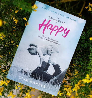 The Sacrament of Happy: What a Smiling God Brings to a Wounded World by Lisa Harper
