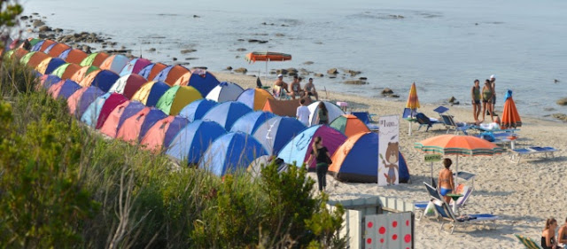 Tents of young people at Rodon Cape beach