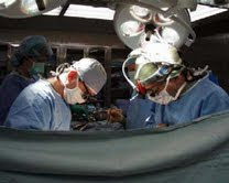 Neurologists in operating theatre