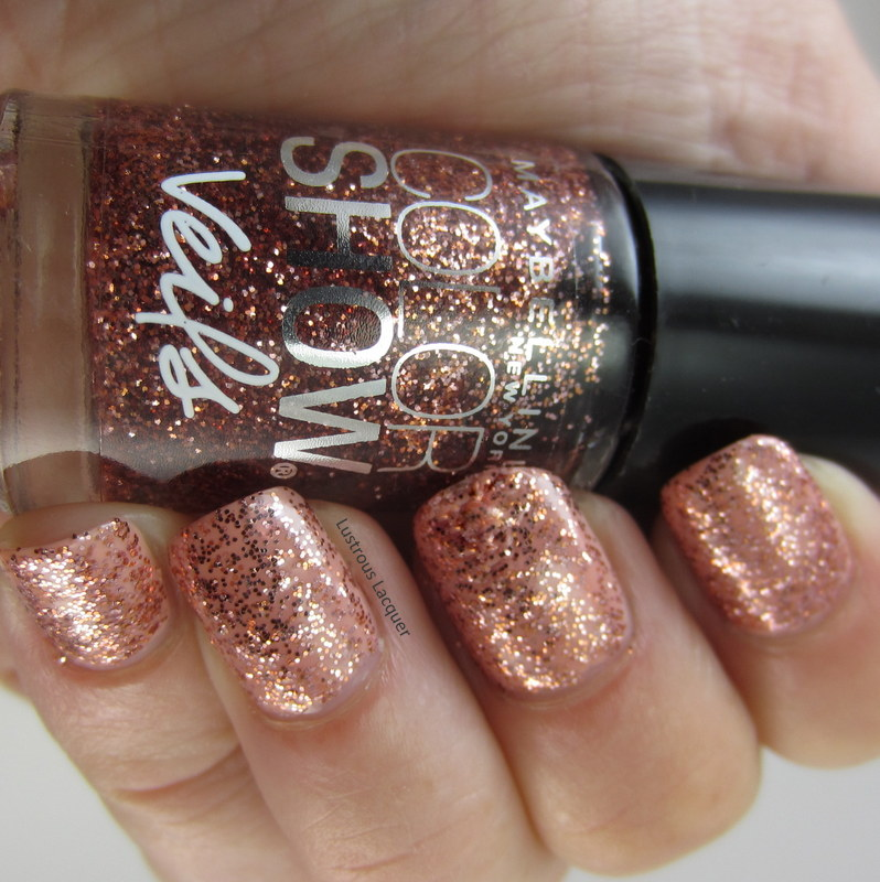 Nail polish with rose gold glitters in a clear base.