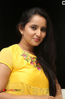 Actress Ishika Singh Pictures in Yellow Dress at Kobbari Matta Teaser Launch  0026.JPG
