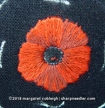 DMC version of the embroidered remembrance poppy with completed red portion of petals