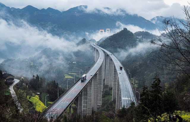 Highest bridge in the world engulfed in clouds