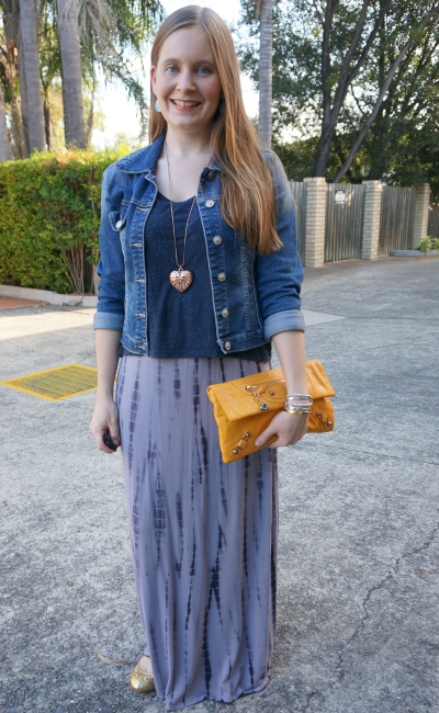 maxi dress layered with cropped tee and denim jacket, yellow Balenciaga envelope clutch | awayfromblue