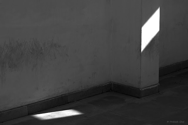 A Black and White Minimalist Photograph of Rhombus and Rectangle created by Light and Shadow play of Nature