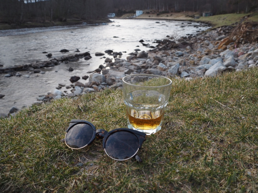 sunglasses and glass of whisky