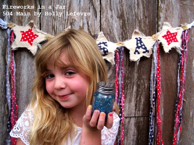 Little gril holding 4th of July craft