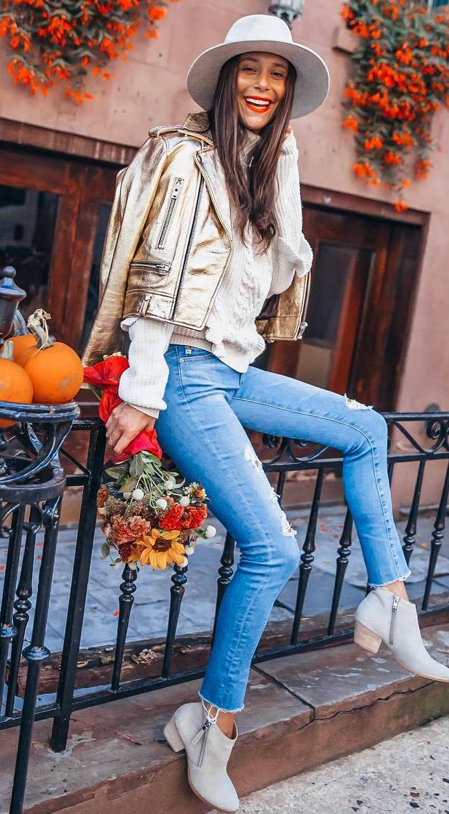 how to style a hat : white sweater + golden biker jacket + rips + boots