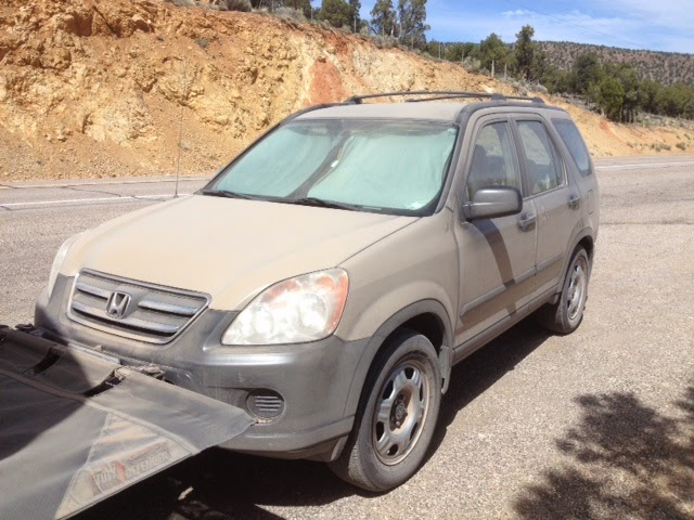 Dusty Honda CRV towed car