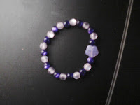 Purple and lavender bracelet with 1 lavender flower bead