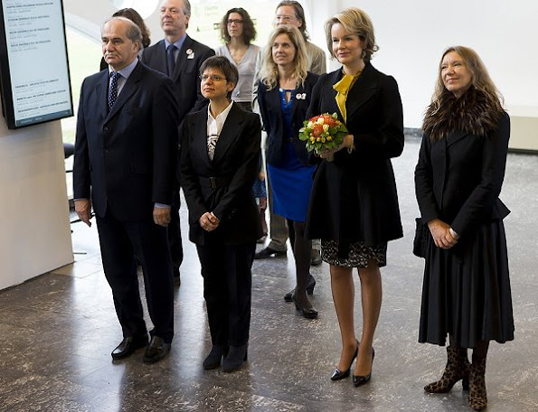 Queen Mathilde wore Temperley London coat, Delphine Nardin Gold Earrings, gold bracelet, Natan blouse, Natan Pumps