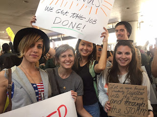 Maurene Goo (center) protesting at LAX with authors Kirsten Hubbard, Sarah Enni, Victoria Aveyard and Alex Kahler