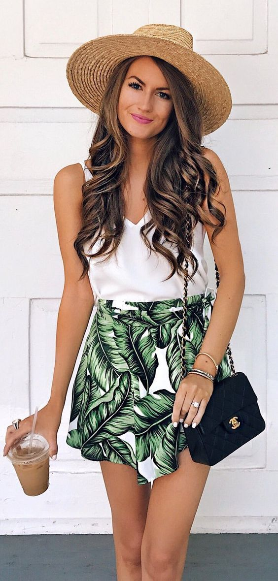 fashion trends / hat + white top + printed skirt + bag