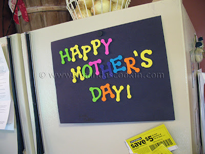 A photo of a happy mother\'s day sign made by one of my sons on the fridge.