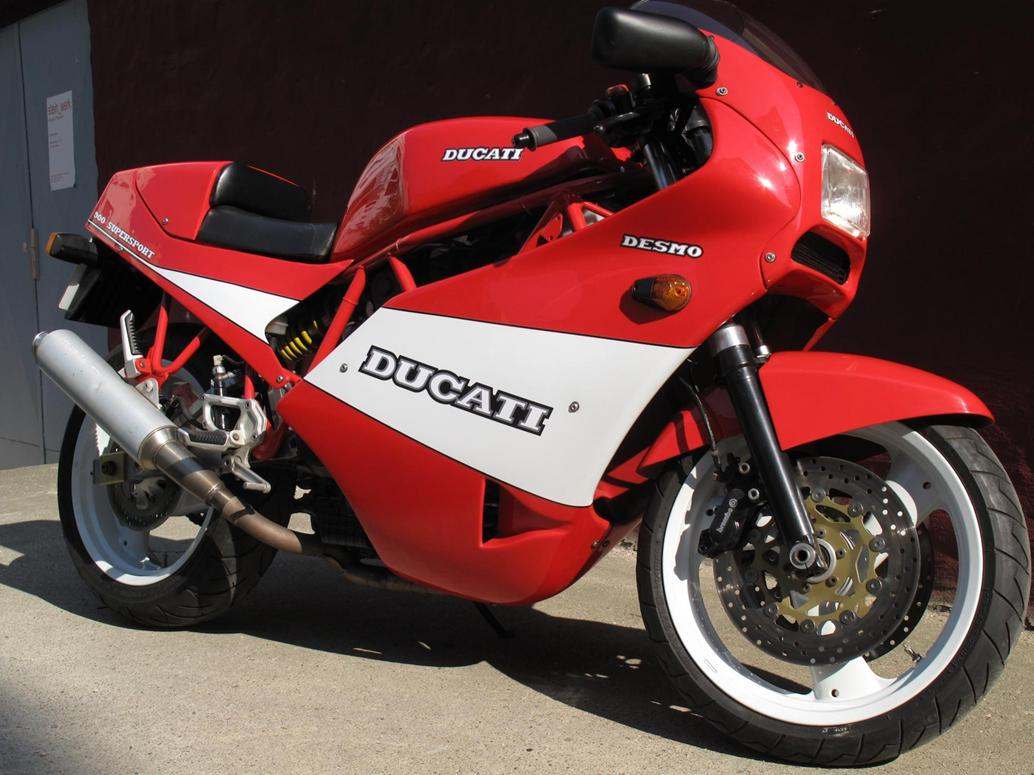 once a humble weber carbed 1989 ducati 900ss this ducati supersport has accidentally become a one off almost money no object woodsmans axe style  [ 1034 x 775 Pixel ]