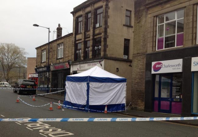 Police forensic team cordon off Chapel Lane in Bingley town centre after man assaulted