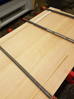 top view of glueup that shows thin slivers of wood protecting the tabletop from clamps