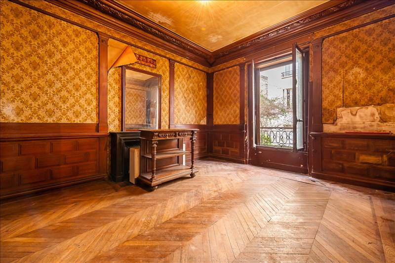 Herringbone wood floors and peeling wallpaper in Paris home for sale seen on Hello Lovely Studio