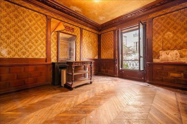 Herringbone wood floors and peeling wallpaper in Paris home for sale seen on Hello Lovely Studio