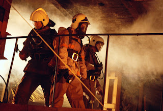 fire fighters in smokey building