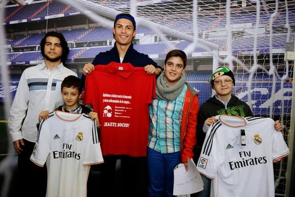 Cristiano Ronaldo poses with four young boys suffering from leukemia