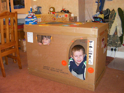 kids in packing crate den