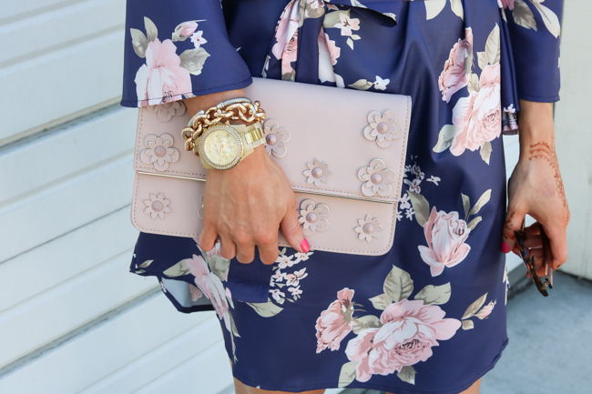 blush clutch and gold link bracelet