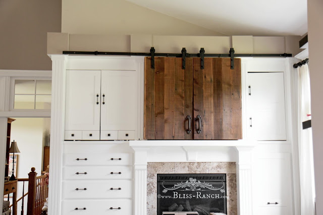 Barn Doors Hiding TV Bedroom Bliss-Ranch.com